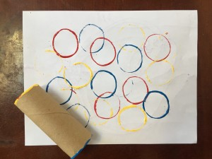 Circle art project painted with end of toilet paper tube