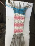 Child's simple weaving project using yarn and cardboard