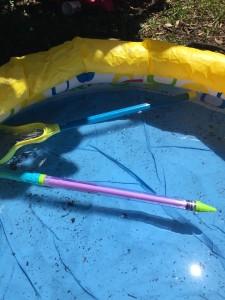 Saber blaster water gun shooter tube floating in inflatable wading pool