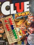 Clue Junior board game for kids in box with football peg game on top