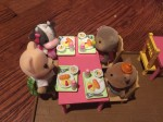 Calico Critters sitting at pink table with School Lunch Set