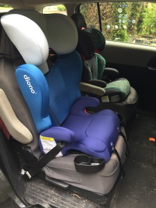Diono Cambria 2 belt positioning booster car seat for kids installed in second row captain's chair of 2012 Mazda5