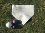 Franklin Sports Throw Down Baseball Bases home plate with plastic and foam baseballs on grass field