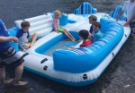 H20Go Bahama Wave Island Float on river with five kids riding inside
