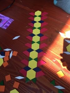 Melissa & Doug pattern blocks laid out on floor