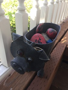 Metal pig decorative pot plant stand filled with rocks