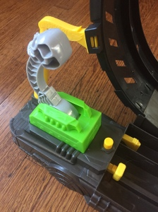 Launch button and lever on Hot Wheels Monster Truck Epic Loop Challenge Set