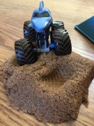 Monster Truck Jam Kinetic Sand Starter Set blue shark truck driving over dirt sand pile