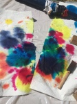 Tie-dye paper towels after dying shirts with Tulip Party Kit in a box
