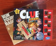 Run Yourself Ragged, Clue Junior and football peg game in stack on wooden floor