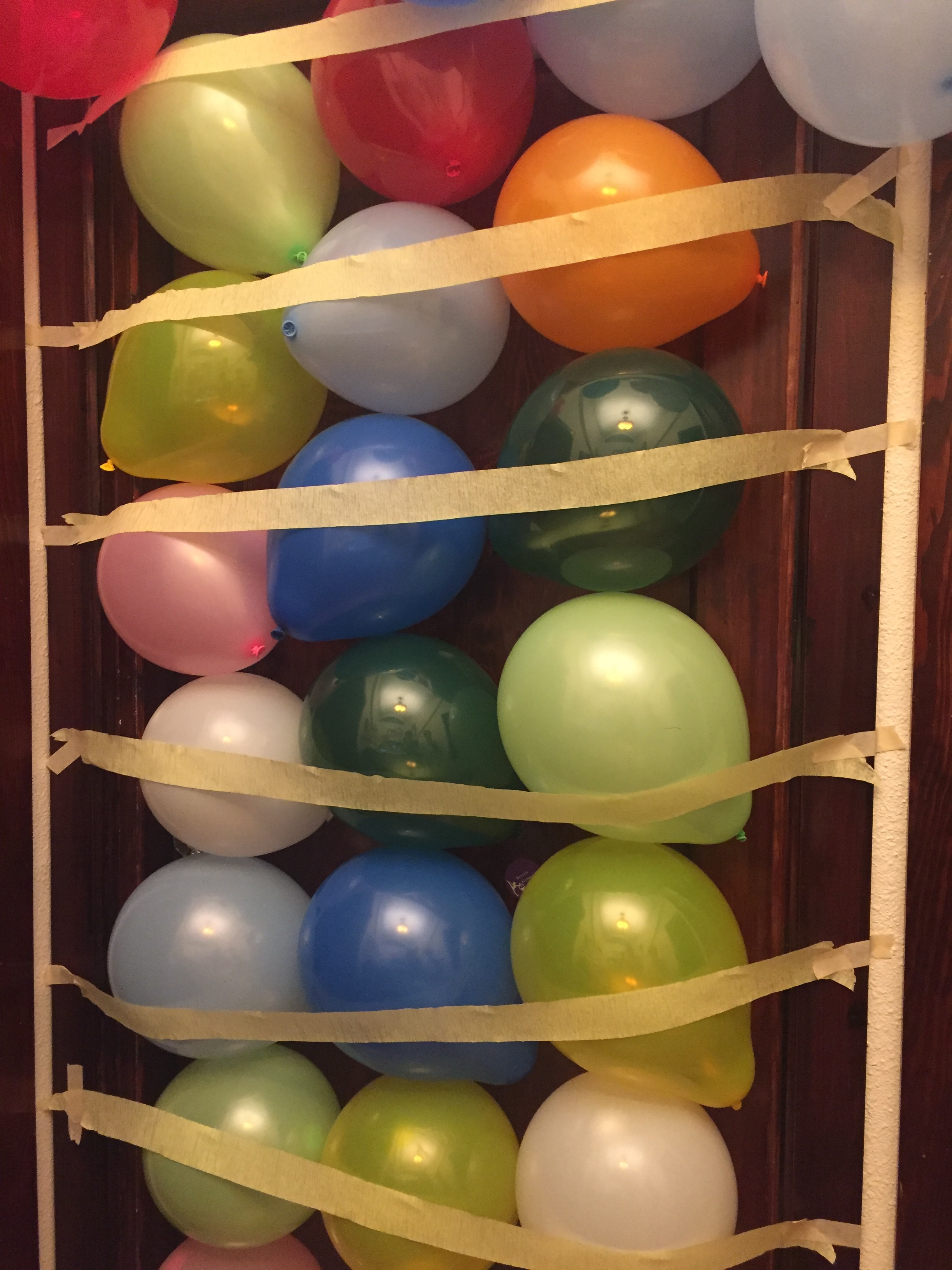 Balloons attached to kid's bedroom door for birthday surprise