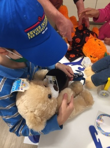 Child dressing birthday bear at Build A Bear store