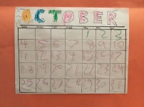 October handmade calendar by five year old child with handwritten numbers