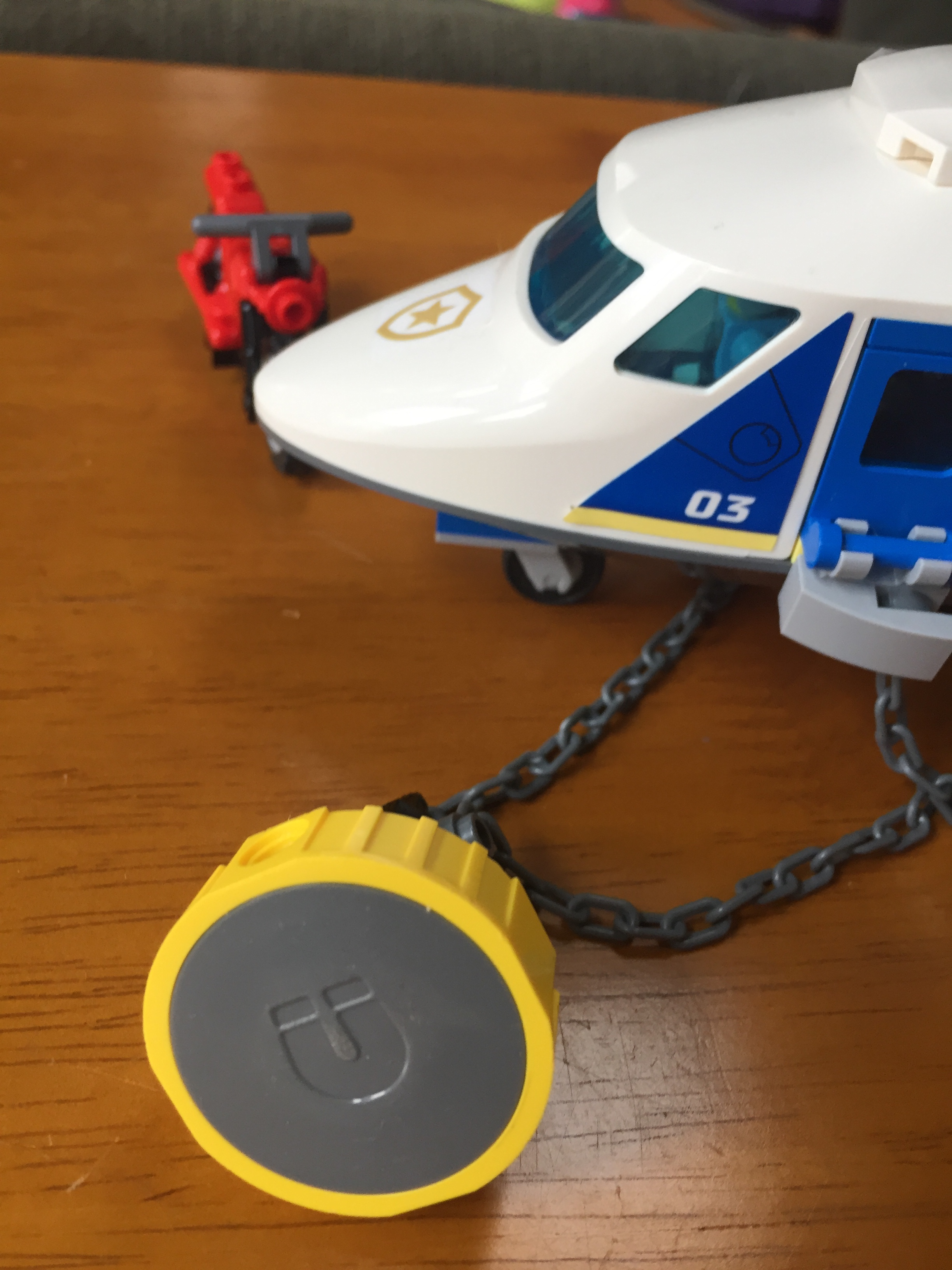 Lego helicopter police chase play set showing magnet attached to chain