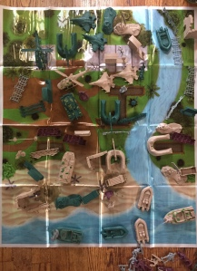 Tiny Troopers Big Battle Drum Army Men Playset play mat spread out with tanks, airplanes, boats, and