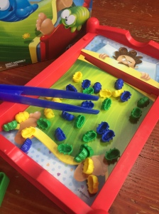 Bed Bugs game by Hasbro bed with 36 plastic bugs in green, yellow, and blue with blue overszied tweezers