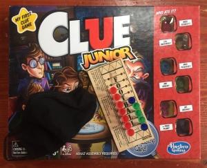 Clue Junior board game for kids, football peg game, black child's face mask