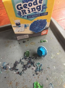 Geode ring science lab kit for kids with bits on cookie sheet