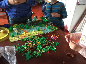 Three kids playing with Jungle Forest Garden Park brick building set offbrand Lego by Yamix