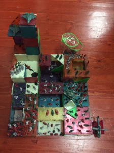 Battle of toy soldiers army men set up on Magna-Tiles fortress