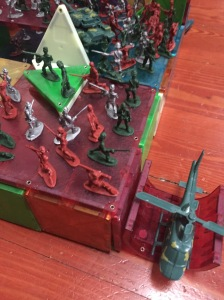 Army men fighting on Magna-Tiles building