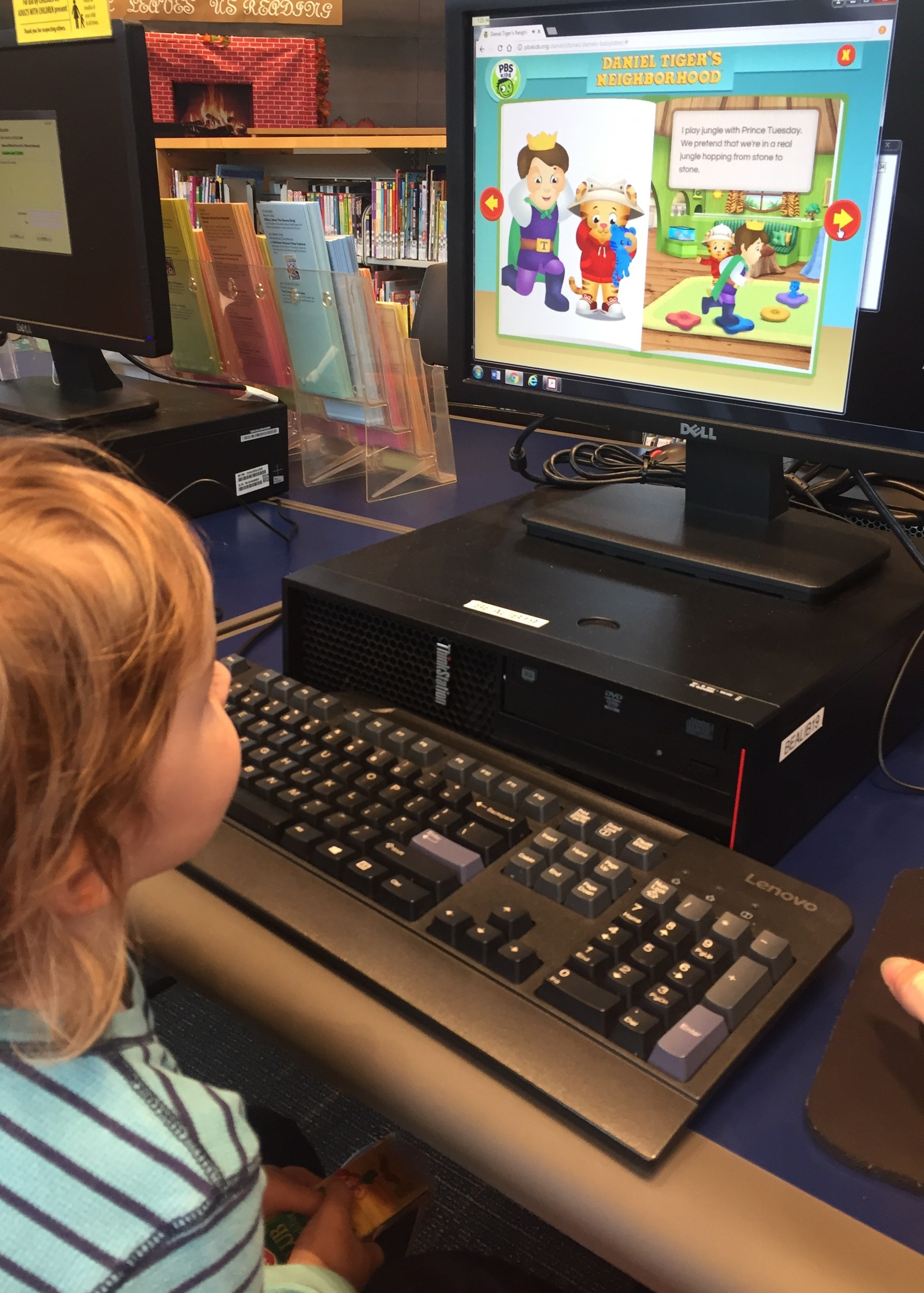 Child looking at PBS kids on computer screen