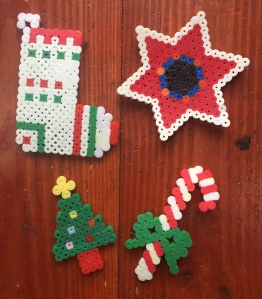 Perle fuse melty bead Christmas ornaments made by kids tree candy cane star and stocking