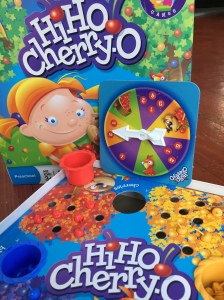 Hi Ho! Cherry-O game for preschoolers with red bucket, board, box lid, and spinner