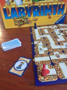 Labyrinth game with treasure card showing knight's helmet and red wizard in starting position