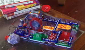 Snap Circuits Jr board with circuit built by five year old boy