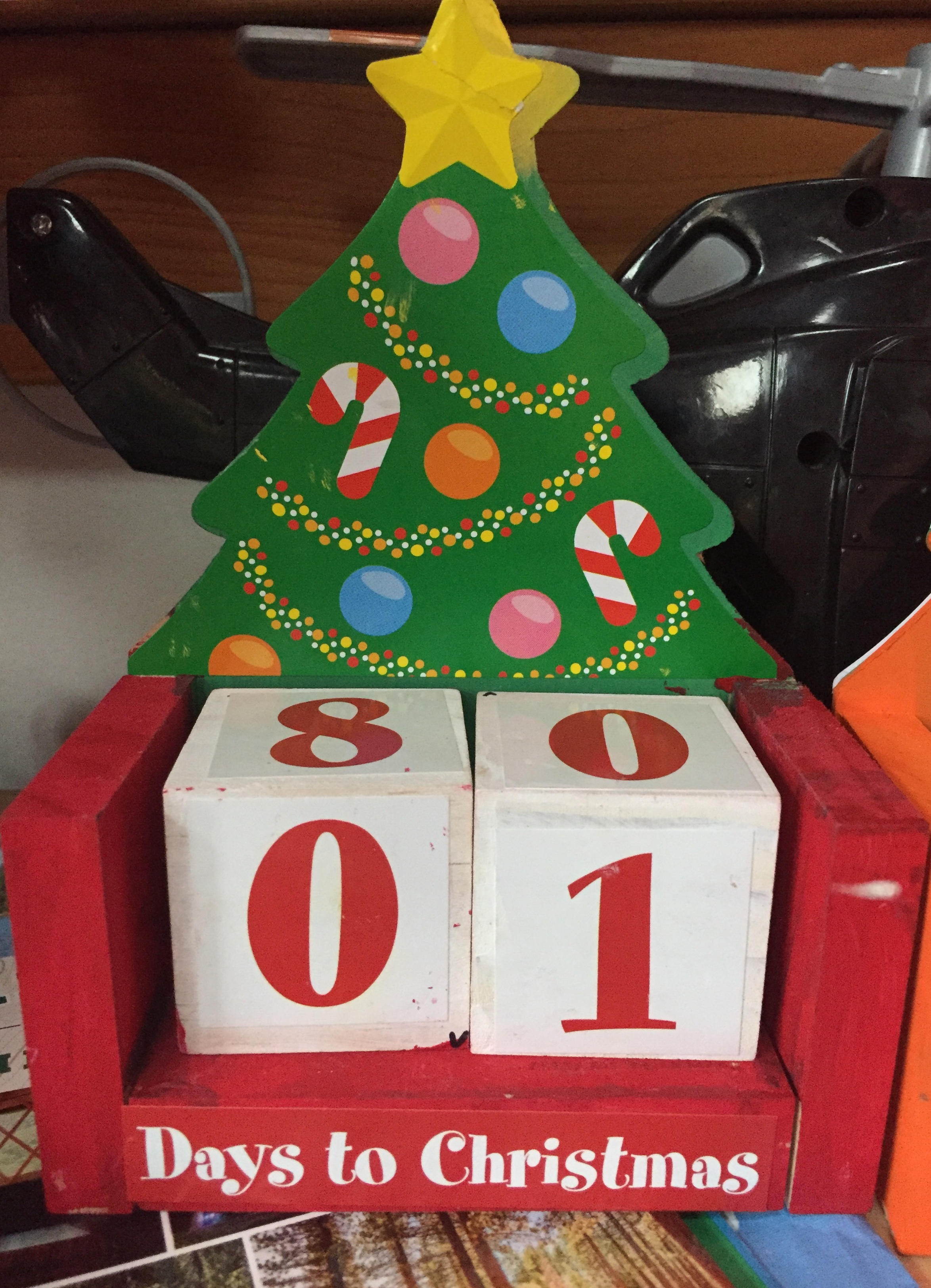 Christmas countdown number blocks in wooden Christmas tree stand showing 1 day left