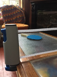 Champion Sports Anywhere Table Tennis set up on coffee table portable ping pong