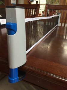 Champion Sports table tennis expandable net attached to dining room table