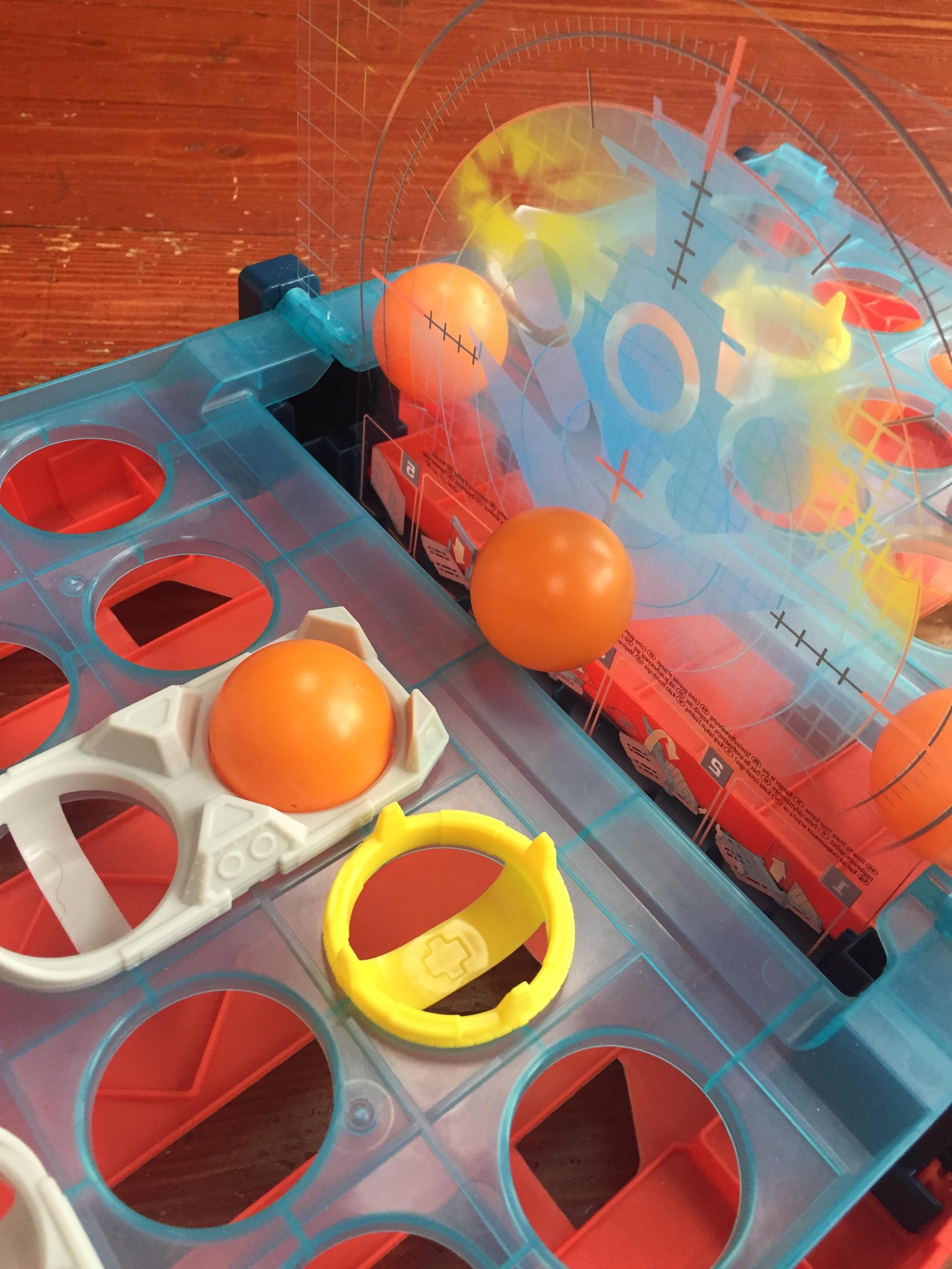 Battleship Shots game set up with orange balls