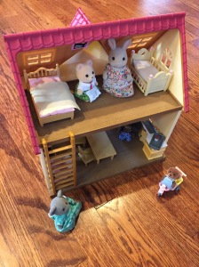 Calico Critters cozy cottage set up with animals and furniture
