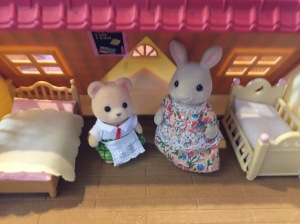 Calico Critters hopscotch rabbit and school lunch bear on second floor of cozy cottage