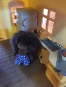 Calico Critters Hedgehog in kitchen of cozy cottage