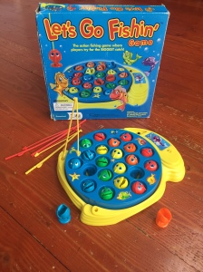 Let's Go Fishin' game from Pressman box rotating pond, fish in red, orange, yellow, green, and blue and four plastic fishing rods