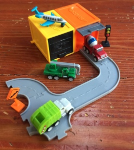 Driven Pocket Series set with blind box garages and connecting gray road pieces