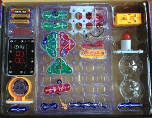 Snap Circuits Arcade pieces in clear plastic organizer inside box