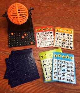 Mini bingo set with tiny orange bingo balls, cage, master board,