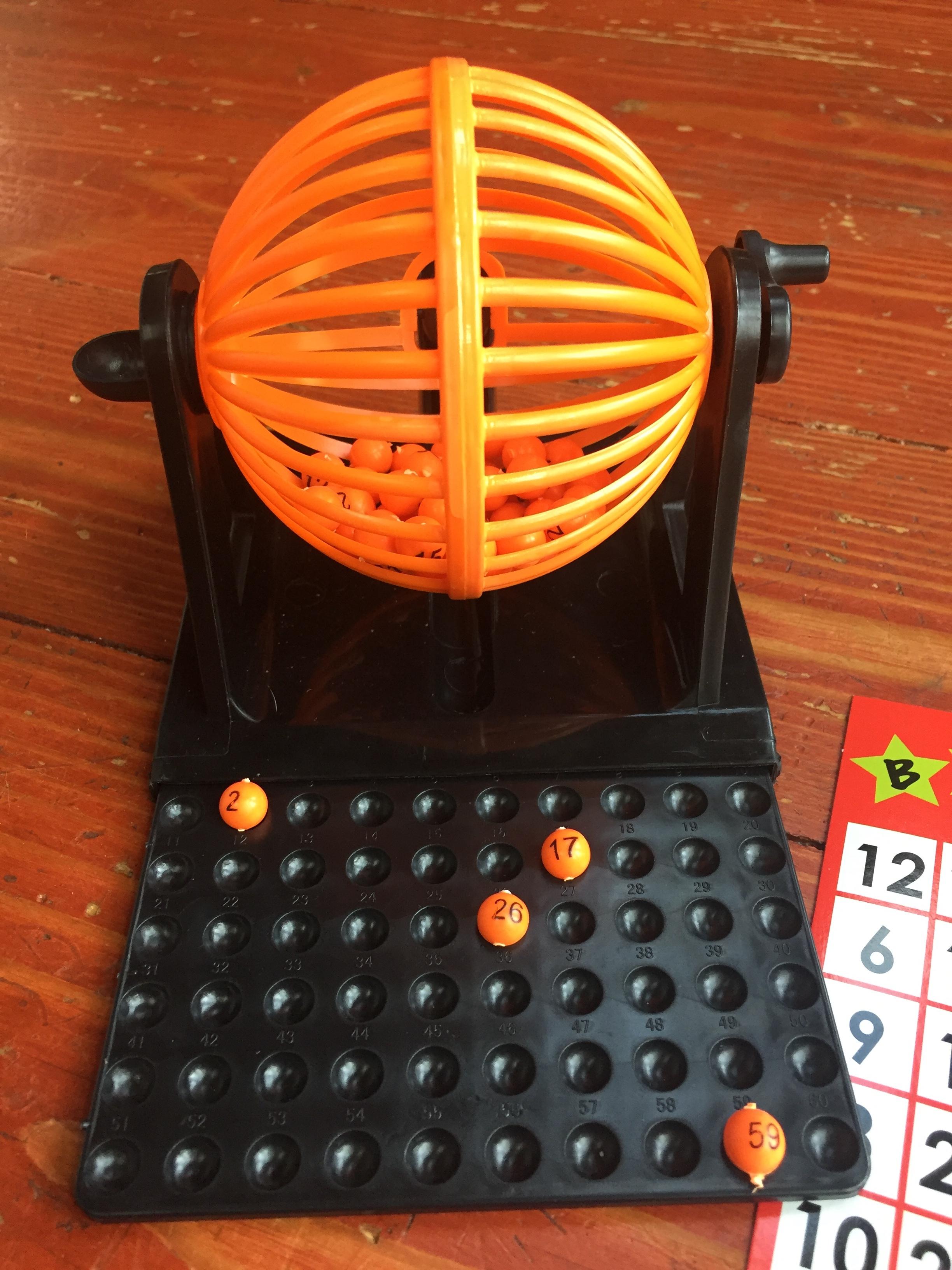 Mini bingo set with cage and tiny orange balls