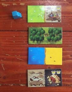 Kingdomino tiles pieces