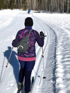 Woman cross country skiing while wearing long leg warmers from American Apparel