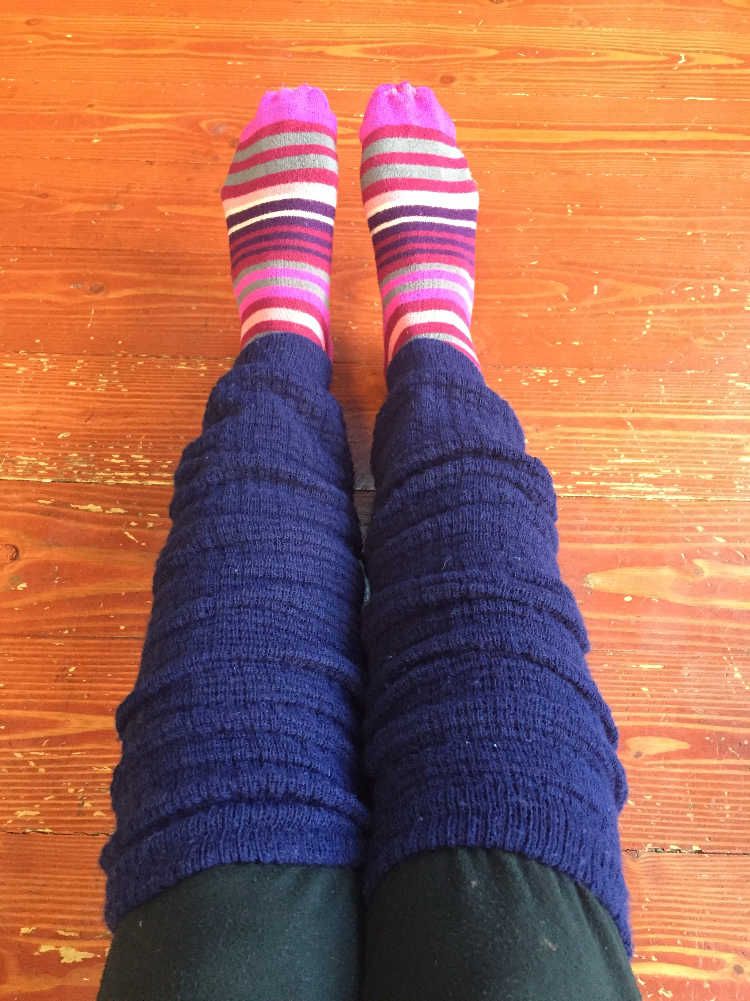American Apparel long leg warmer in navy worn over striped socks and black joggers