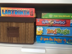 Games for toddlers and preschoolers stacked on shelf