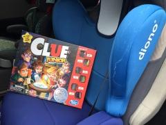 Clue Junior board game for kids sitting in Diono Cambria