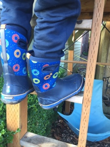 Child climbing ladder while wearing Bogs big kid boots size five