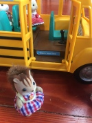 Calico Critters School Bus with door open and kid squirrel waiting to get on