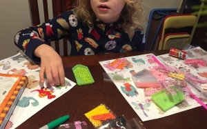 Child working on art project diamond painting